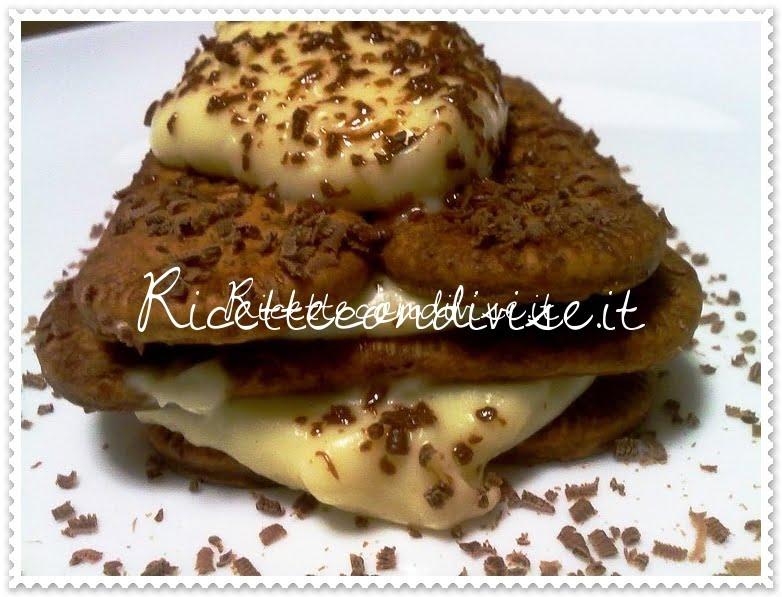 Primo piano tiramisù con crema di yogurt alla vaniglia e grappa profumato al cappuccino dello chef Matteo Ghigino