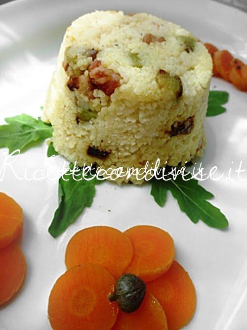 Primo piano Monoporzioni di cous cous con pancetta e melanzane a cubetti di Susi