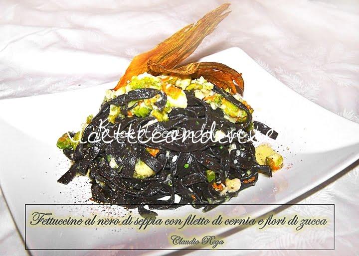 Fettuccine al nero di seppia con filetto di cernia e fiori di zucca di Claudio Rega