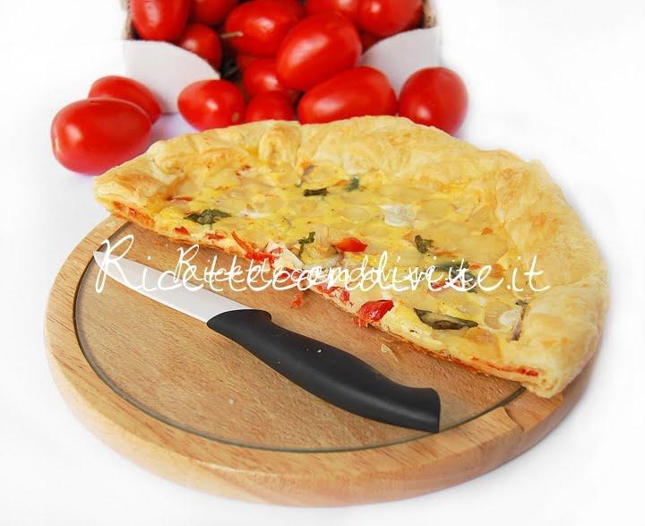 Particolare torta salata con pomodorini cipolla ed emmenthal di Dany - Ideericette