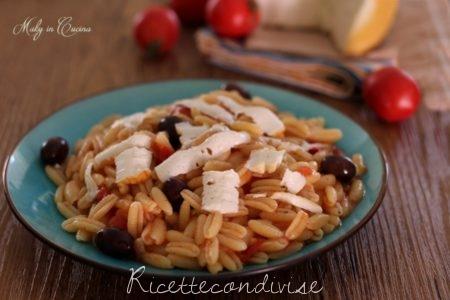 Gnocchetti con pomodorini olive e ricotta salata